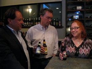 Liz Pliska, with Nelson Veiga (left) and Jamie Webb