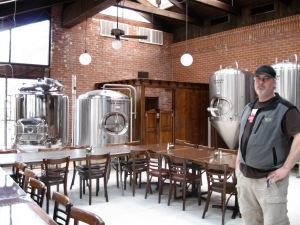 John Watson at Pies & Pints in Waterbury, Conn., where he hopes to use those tanks in the background.